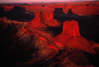 Castle Valley's regal monoliths shadow redrock near Moab, Utah. Long shunned for its tortured terrain, the Moab area first found celebrity in 1949, after director John Ford shot Wagon Master there. Since then, picture-perfect scenery has provided sets for more than two-dozen films.