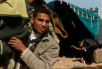 Ras Ajdir, Feb 24, 2011.Thousands of refugees, mostly Tunisians but also Egyptians and Libyans flee the ongoing revolutions and blood fights inside Libya.