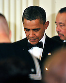 United States President Barack Obama bows his head in prayer as he and first lady Michelle Obama host a dinner to honor our Armed Forces who served in Operation Iraqi Freedom and Operation New Dawn and to honor their families in the East Room of the White House in Washington, D.C. on Wednesday, February 29, 2012..Credit: Ron Sachs / Pool via CNP
