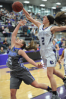 NWA Democrat-Gazette/ANDY SHUPE<br /> Rogers guard Emma Wisdom (5) has her shot blocked by Fayetteville guard Sasha Goforth (2) Friday, Feb. 10, 2017, during the second half of play in Bulldog Arena. Visit nwadg.com/photos to see more photographs from the game.