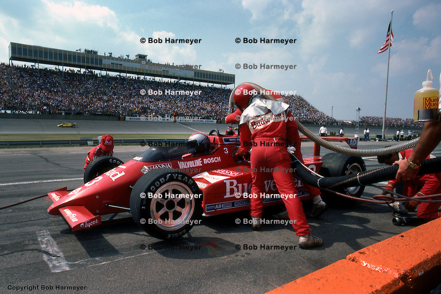 BROOKLYN, MI - JULY 22: Mario Andretti makes a pit stop in his  Lola T800/Cosworth during the CART IndyCar event on July 22, 1984, at Michigan International Speedway near Brooklyn, Michigan.