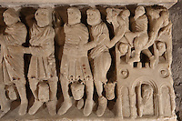 Roman soldiers with monstrous animals between their legs, about to arrest St Sernin, and on the right, an acrobat on his rope and people watching from their windows, on the sarcophagus of St Sernin, by the Master of Cabestany in Romanesque style, mid 12th century, in the Saint-Hilaire-D'Aude Abbey, built 11th - 14th centuries and closed 1748, when it became a parish church, Saint-Hilaire, Aude, Languedoc-Roussillon, France. St Hilary built the first chapel on this site in the 6th century, dedicated to St Sernin. In the 10th century his relics were discovered here and the church, then an abbey, rededicated to St Hilaire. Picture by Manuel Cohen