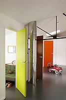 Each boy has chosen a different colour for his bedroom door which opens out to a communal playroom