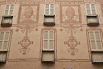 A decorated building facade in Como, Italy