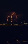 Lightning strike at nighttime West Seattle Elliott Bay