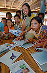 Women study conservation booklets, Papagaran island, Komodo National Park
