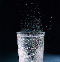 CARBONATION - CO2 BUBBLES IN GLASS OF ALKA SELTZER<br /> Alka Seltzer is a combination of sodium bicarbonate and citric acid. When it is dropped into water, carbon dioxide is released and bubbles up to the surface.