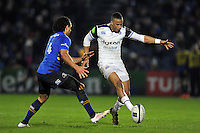 Anthony Watson of Bath Rugby puts boot to ball. European Rugby Champions Cup match, between Leinster Rugby and Bath Rugby on January 16, 2016 at the RDS Arena in Dublin, Republic of Ireland. Photo by: Patrick Khachfe / Onside Images