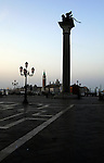 View of San Giorgio Maggiore, from St Marks square showing the column with the statue of the Lion of St Mark, Venice, Italy.