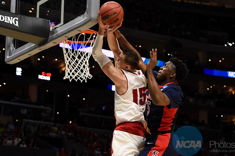 28 MAR 2015:  Sam Dekker (15) of the University of Wisconsin drives past Stanley Johnson (5) of the University of Arizona during the 2015 NCAA Men's Basketball Tournament held at the Staples Center in Los Angeles, CA.  Wisconsin defeated Arizona 85-78 to advance to the Final Four.  Jamie Schwaberow/NCAA Photos