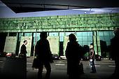 Warsaw 05.04.2008 Poland<br /> People standing on a bus stop near the brand new Warsaw University Library<br /> (Photo by Adam Lach / Napo Images for Newsweek Polska)<br /> <br /> Ludzie stoja na przystanku autobusowym tuz przy Warszawskiej Bibliotece Uniwersyteckiej<br /> (Fot Adam Lach / Napo Images dla Newsweek Polska)