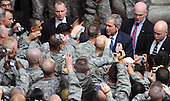 Baghdad, Iraq - December 14, 2008 -- United States President George W. Bush meets with United States military personnel during a surprise visit to Al Faw Palace, Camp Victory, Iraq, on Sunday, December 14, 2008.  .Credit: Brandon Price - U.S. Army via CNP