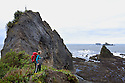 WA11267-00...WASHINGTON - Hiker on the high tide trail over Hole-In-The-Wall along the Rialto Beach hike. (MR #S1)