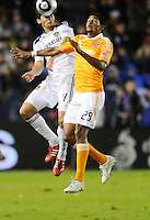 Los Angeles Galaxy's (4) Omar Gonzalez fights off Houston Dynamo's (29) Carlos Costly for the ball in the second half. The Galaxy won 1-0 in the MLS Cup at the Home Depot Center. Los Angeles Galaxy 1-0 over the Dynamo USA, Sunday, Nov. 20. 20011, in Carson, California. Photo by Matt A. Brown/isiphotos.com