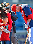 11 October 2012: Washington Nationals rookie outfielder Bryce Harper signs autographs prior to Postseason Playoff Game 4 of the National League Divisional Series against the St. Louis Cardinals at Nationals Park in Washington, DC. The Nationals defeated the Cardinals 2-1 on a 9th inning, walk-off solo home run by Jayson Werth, tying the Series at 2 games apiece. Mandatory Credit: Ed Wolfstein Photo
