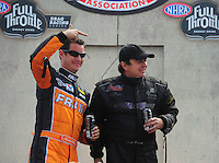 Aug. 7, 2011; Kent, WA, USA; NHRA top fuel dragster driver Spencer Massey (left) jokes with Scott Palmer during the Northwest Nationals at Pacific Raceways. Mandatory Credit: Mark J. Rebilas-