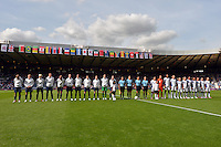 Glasgow, Scotland - July 25, 2012: USA and France Women's Olympic Soccer Teams before their match at Hampden Stadium in Glasgow, Scotland during the London Olympics.