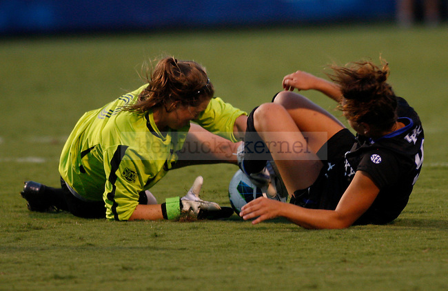 Junior forward Caitlin Landis falls to the ground at Women's Soccer vs. UNC Greensboro at the UK Soccer Complex in Lexington, Ky., on Friday, August 31, 2012. Photo by Tessa Lighty | Staff