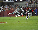 Alabama wide receiver Amari Cooper (9) is tackled by Ole Miss defensive back Charles Sawyer (3) and Ole Miss defensive back Trae Elston (7) at Bryant-Denny Stadium in Tuscaloosa, Ala. on Saturday, September 29, 2012. Alabama won 33-14. Ole Miss falls to 3-2.