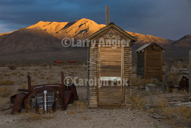 Outhouses; light fading off Mt. Dunfee, Nevada