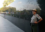 A National Park Service officer keeps watch over the Korean War Memorial in Washington, D.C. during early July 2008.