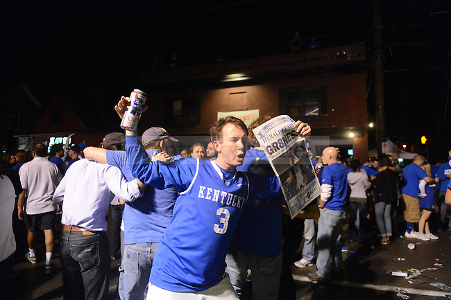 UK fan Charlie Rowland celebrates at the intersection of Woodland Ave. and Euclid Ave. in Lexington, Ky., after their victory over Kansas in the NCAA Basketball Championship game on 4/3/12. Photo by Mike Weaver   Staff