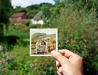 The photographer holds a family snapshot - taken in 1969 - at the same location in 2007. Neopardy,Devon, England.<br />
