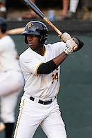 Right fielder Nick Buckner (34) of the Bristol Pirates bats in a game against the Greeneville Astros on Saturday, July 26, 2014, at DeVault Memorial Stadium in Bristol, Virginia. Greeneville won, 2-1 in Game 1 of a doubleheader. (Tom Priddy/Four Seam Images)