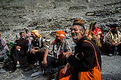 Hindu pilgrims stop to rest along the Amarnath trekking route in Kashmir, India. Hindu pilgrims brave sub zero temperature and high latitude passes and make their pilgrimage to reach the sacred Amarnath cave, which houses a lingam - a stylized phallus, worshiped by Hindus as a symbol of God Shiva. Photo: Sanjit Das/Panos