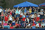Ole Miss students catch a ball used in warm-ups between innings from Ole Miss' Jordan King (10) vs. Wright State at Oxford University Stadium in Oxford, Miss. on Saturday, February 19, 2011. Students write messages on the ball before  throwing it back to the outfielders the next inning.