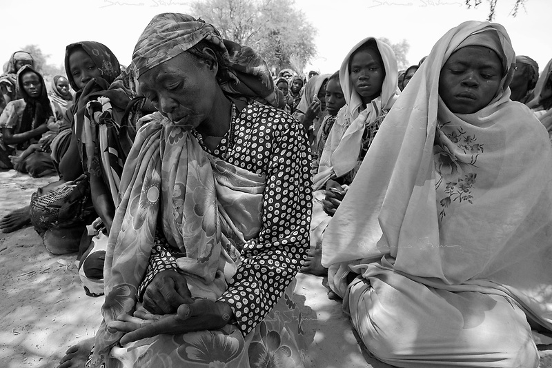 Berbera, Eastern Tchad, June 15, 2004.Harna ismael, his mother, family members and friends mourn Ahmad Adam Ismael, 21, one of three villagers killed the day before by bullets during a Janjavid attack over the Tchadian border.
