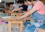 Students work on bamboo basket ware inside the Beppu Traditional Bamboo Crafts Center  in Beppu City, Oita Prefecture, Japan on Sept. 20. 2016.  ROB GILHOOLY PHOTO