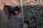 Palestinian refugee children are seen at their makeshift house in a poor suburb in the eastern Gaza City on Sept. 29, 2012. According to local and international humanitarian organization the rate of poverty in the crowded Gaza strip is estimated that about 40% live under the poverty line as unemployment rate for refugees in Gaza has reached 42 percent. Photo by Emad Nassar