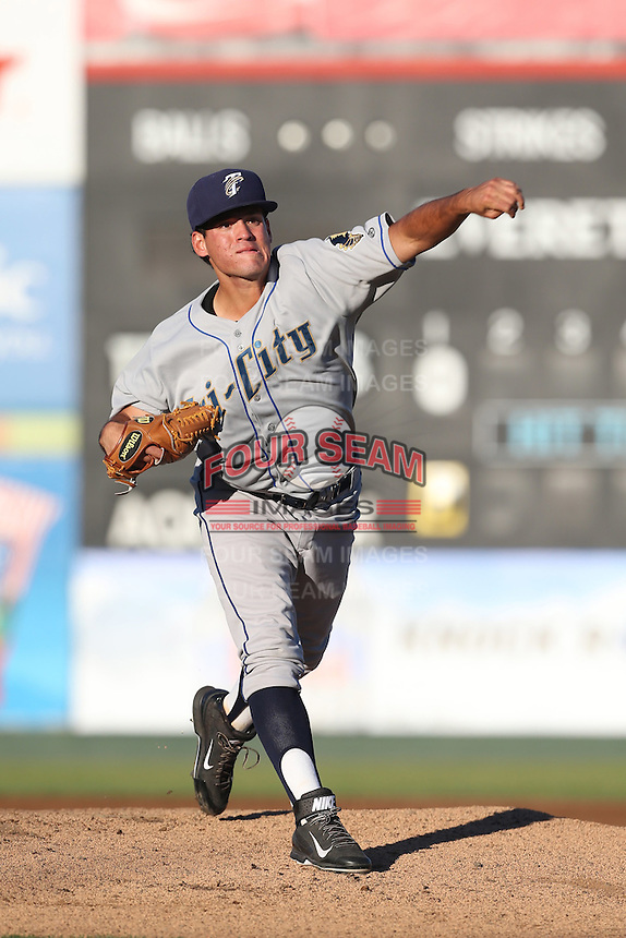 Helmis Rodriguez #33 of the Tri-City Dust Devils pitches against the Everett AquaSox at Everett Memorial Stadium on July 29, 2014 in Everett, Washington. Everett defeated Tri-City, 7-5. (Larry Goren/Four Seam Images)
