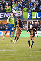 Roger Levesque (24) and Andrew Jacobson (8) go up for a header as the Seattle Sounders defeated the Philadelphia Union, 2-0, in an MLS match on Thursday, March 25, 2010 at Qwest Field in Seattle, WA. It was the Sounders home opener and the first regular season game for the expansion Philadelphia Union.