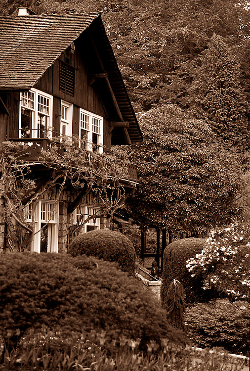 Stanley Park Pavilion, Swiss Chalet style tea house, now restaurant, (Otto Moberg, 1911), surrounded by trees and blossoms in Spring, Vancouver, BC.