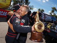 Aug 21, 2016; Brainerd, MN, USA; NHRA  top alcohol funny car driver Jonnie Lindberg celebrates with crew members after winning the Lucas Oil Nationals at Brainerd International Raceway. Mandatory Credit: Mark J. Rebilas-USA TODAY Sports