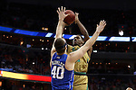 10 March 2016: Notre Dame's Demetrius Jackson (behind) shoots over Duke's Marshall Plumlee (40). The University of Notre Dame Fighting Irish played the Duke University Blue Devils at the Verizon Center in Washington, DC in the Atlantic Coast Conference Men's Basketball Tournament quarterfinal and a 2015-16 NCAA Division I Men's Basketball game. Notre Dame won the game 84-79 in overtime.