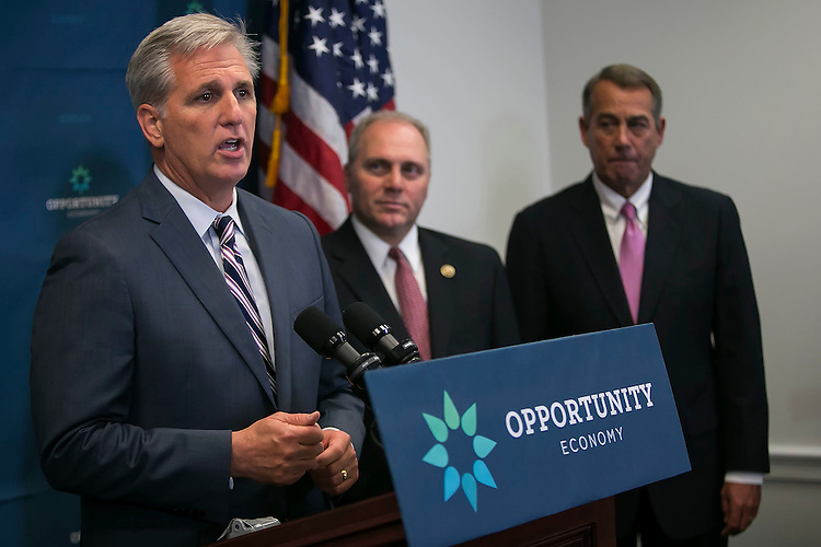 UNITED STATES - September 29: House Majority Leader Kevin McCarthy, R-Calif., speaks beside House Majority Whip Steve Scalise, R-La., center, and outgoing Speaker of the House John Boehner, R-Ohio, right, during a news conference on Capitol Hill in Washington, Tuesday, Sept. 29, 2015. McCarthy is reinforcing to Republicans that he can keep them united, despite conservatives trying to move their party to the right after Boehner's sudden resignation. (Photo By Al Drago/CQ Roll Call)