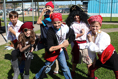 Students from Horn Academy pose as pirates for part of their Odyssey of the Mind competition.
