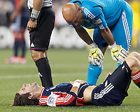 New England Revolution goalkeeper Matt Reis (1) checks out teammate, New England Revolution midfielder Stephen McCarthy (26). In a Major League Soccer (MLS) match, the New England Revolution tied the Columbus Crew, 0-0, at Gillette Stadium on June 16, 2012.