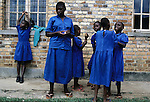 RWAMAGANA, RWANDA - FEBRUARY 26: School girls take a break from classes at a school for the blind, Ecole de Aveugle de Rwamgana, February 26, 2003 in Rwamagana, 40 kilometers east of Kigali, Rwanda. Many children here are victims of the genocide in 1994. Some children have injuries due to grenade splinters or have been victims of landmines. Many are traumatized by the experiences and some don't have any relatives left. 800,000 mainly Tutsis and moderate Hutus were killed in about one hundred days in Rwanda in 1994. About 100,000 prisoners accused of the genocide are still in prisons nine years later awaiting trials. Rwanda is currently trying to cope with these problems of crime, punishment and reconciliation through village trials called Gacacas. Gacaca, which means on the grass, is a traditional way of solving disputes between local communities and involve juries of residents. 11,000 gacacas are currently trying to resolve crimes from the genocide. (Photo by Per-Anders Pettersson)