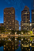 The Discovery Green park in downtown Houston is nessled between many skyscrapers.  This angle across the lake gave a nice view of the city as the lights came on in the high rise buildings and a nice reflection in the waer of the buildings as darkness approached. Watermark will not appear on image