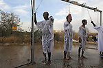 Eritrean asylum-seekers, living in Israel, baptize under showers streaming Jordan River water, during the Feast of the Epiphany, at the baptismal site of Qasr el Yahud on the Jordan River western bank. The spot is believed to be  where John the Baptist baptized Jesus, near the West Bank town of Jericho.