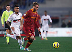 Calcio, Serie A: Roma vs Milan. Roma, stadio Olimpico, 22 dicembre 2012..AS Roma midfielder Daniele De Rossi is chased by AC Milan midfielder Kevin Prince Boateng, of Ghana, left, during the Italian Serie A football match between AS Roma and AC Milan at Rome's Olympic stadium, 22 December 2012..UPDATE IMAGES PRESS/Isabella Bonotto