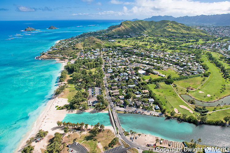 Aerial view of Kailua Beach park and the Mid-Pacific Country Club golf course. The turquoise waters of the Pacific caress Kailua Beach, Lanikai beach, and the Mokulua Islands.