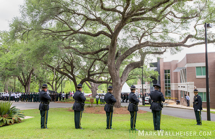 The Leon County Sheriff's Office give a 21 gun salute during the Florida Sheriffs Association 2017 Law Enforcement Memorial Ceremony at the Florida Sheriffs Association in Tallahassee, Florida.