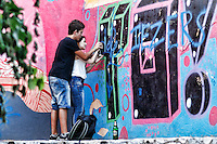 Making graffiti in the street of Athens, Greece