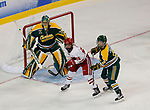 ST CHARLES, MO - MARCH 19:  Emily Clark (26) of the Wisconsin Badgers and Corie Jacobson (2) of the Clarkson Golden Knights jockey for position in front of Clarkson goalie Shea Tiley (35) during the Division I Women's Ice Hockey Championship held at The Family Arena on March 19, 2017 in St Charles, Missouri. Clarkson defeated Wisconsin 3-0 to win the national championship. (Photo by Mark Buckner/NCAA Photos via Getty Images)