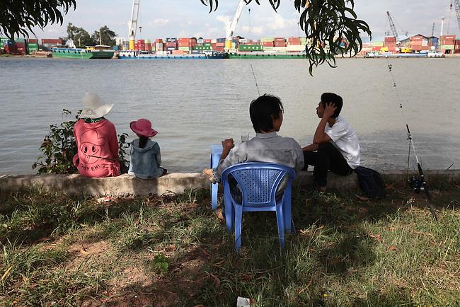 Fishermen wait for a bite on the Saigon River outside Ho Chi Minh City, Vietnam. Aug. 11, 2011.